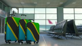 Travel suitcases with flag of Tanzania. Tanzanian tourism conceptual 3D animation. Traveler`s suitcases with flag. Tourism related 3D royalty free illustration