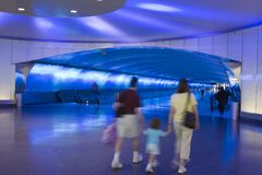Traveler's Under the Tarmac. This intentionally blurry image is of travelers moving under the tarmac at Detroit International Airport. The focus of the image is royalty free stock image