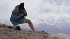 Traveler sets action camera for takes pictures of the mouintains landscape. stock footage