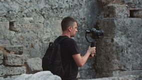 A traveler shoots video footage in the Ruins of the Antique City stock video footage