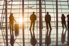 Traveler silhouettes at airport Royalty Free Stock Photos