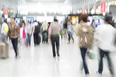 Traveler silhouettes in motion blur, airport interior Royalty Free Stock Photography