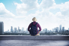 A traveler sitting on the rooftop Royalty Free Stock Image