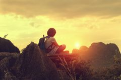 traveler sitting on top mountain with looking sunset Royalty Free Stock Photo