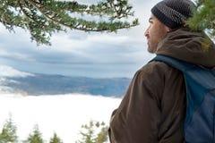 Traveler in the snowy mountains stock photos