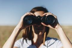 Traveler spying through binoculars Royalty Free Stock Photos