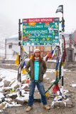 Traveler standing front of Khardung La pass road sign Royalty Free Stock Photo