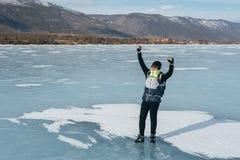 Traveler standing on ice. Royalty Free Stock Photos