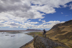 Traveler standing on peak of mountain in Asolfsstadhir, Iceland Stock Photography