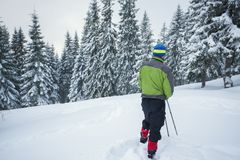 Traveler stands in a deep snow Stock Photography