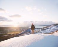 Traveler staring at the sunset. Stock Photos