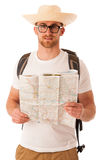 Traveler with straw hat, white shirt, backpack and map seems lik Stock Photo