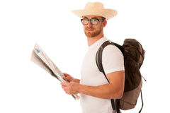 Traveler with straw hat, white shirt, backpack and map seems lik Stock Photography