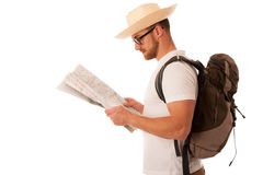 Traveler with straw hat, white shirt, backpack and map seems lik Royalty Free Stock Photo