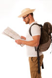 Traveler with straw hat, white shirt, backpack and map seems lik Stock Images