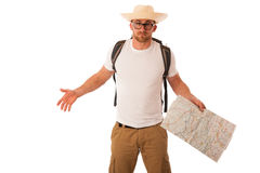 Traveler with straw hat, white shirt, backpack and map seems lik. E he is lost isolated over white background Royalty Free Stock Photo