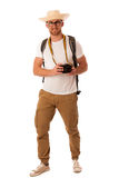 Traveler with straw hat, white shirt, backpack and photo camera. Exploring new world isolated Royalty Free Stock Images