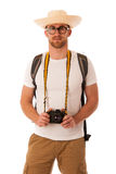Traveler with straw hat, white shirt, backpack and photo camera. Exploring new world isolated Stock Images