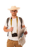 Traveler with straw hat, white shirt, backpack and photo camera. Exploring new world isolated Stock Photography