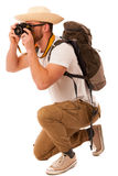 Traveler with straw hat, white shirt, backpack and photo camera. Exploring new world isolated Royalty Free Stock Photo