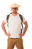 Traveler with straw hat, white shirt and backpack standing isola. Ted over white background Royalty Free Stock Image