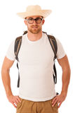 Traveler with straw hat, white shirt and backpack standing isola. Ted over white background Royalty Free Stock Photography