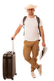 Traveler with straw hat, white shirt, backpack and suitcase wait. Ing for transport isolated Stock Image