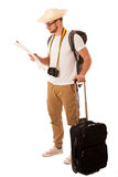 Traveler with straw hat, white shirt, backpack and suitcase wait. Ing for transport isolated Royalty Free Stock Images