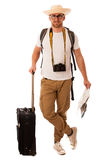 Traveler with straw hat, white shirt, backpack and suitcase wait. Ing for transport isolated Royalty Free Stock Photo