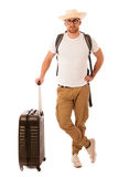 Traveler with straw hat, white shirt, backpack and suitcase wait. Ing for transport isolated Stock Photography