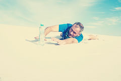 Traveler suffering from thirst lost in the desert Royalty Free Stock Photography