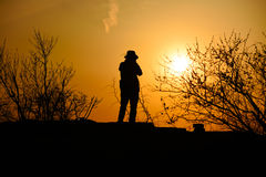 Traveler with sunset in dusk Royalty Free Stock Photos