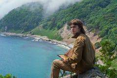 Traveler in taiga at sea 1 Stock Image