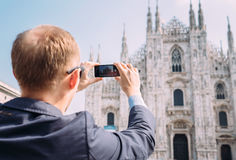 Traveler take a photo of Duomo di Milano with his smartphone Royalty Free Stock Images