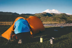Traveler with tent camping equipment outdoor Travel. Lifestyle concept journey adventure active vacations Royalty Free Stock Photos