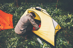 Traveler with tent camping equipment outdoor. Travel Lifestyle concept journey adventure active vacations Royalty Free Stock Images