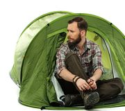 Traveler in a tent Stock Photo