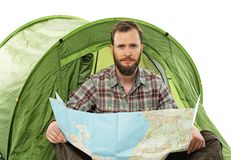 Traveler in a tent with a map Stock Photos