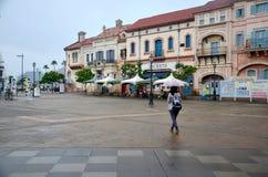 Traveler thai woman posing portrait holding umbrella walking tra Stock Photo
