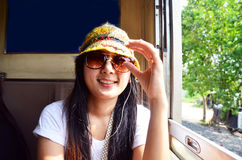 Traveler Thai woman on Railway Train at Thailand Royalty Free Stock Image