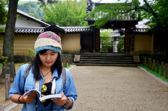 Traveler thai woman reading guide book for travel Nara city in g royalty free stock images