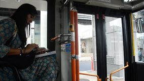 Traveler thai woman sit on bus at Saitama city go to Kawagoe. SAITAMA, JAPAN - OCTOBER 19 : Traveler thai woman sit on bus at Saitama city go to Kawagoe or stock footage