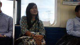 Traveler thai woman sitting on train from Tokyo city go to Saitama city. TOKYO, JAPAN - OCTOBER 19 : Traveler thai woman sitting on Express Electric Railway stock video