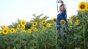 Traveler thai woman use camera portrait and selfie in sunflower flower field stock video