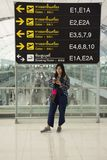 Traveler thai women posing for take photo with general and information board. Inside of Suvarnabhumi international airport on August 23, 2017 in Bangkok Stock Photos