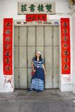 Traveler thai women posing for take photo with retro wooden door and antique lock door chinese old style of house at Chaozhou stock photos