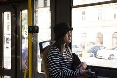 Traveler thai women sitting in retro tramway go to travel around Prague city. Traveler thai woman sitting in retro tramway go to travel around Prague city and Royalty Free Stock Images