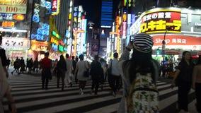 Traveler thai women walking cross over road at crosswalk at Shinjuku. TOKYO, JAPAN - OCTOBER 20 : Traveler thai women walking cross over road at crosswalk at stock footage