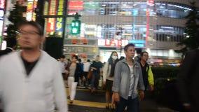 Traveler thai women walking cross over road at crosswalk at Shinjuku. TOKYO, JAPAN - OCTOBER 20 : Traveler thai women walking cross over road at crosswalk at stock video