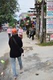 Traveler Thai women walking on street go to Phewa Tal or Fewa Lake Royalty Free Stock Photography